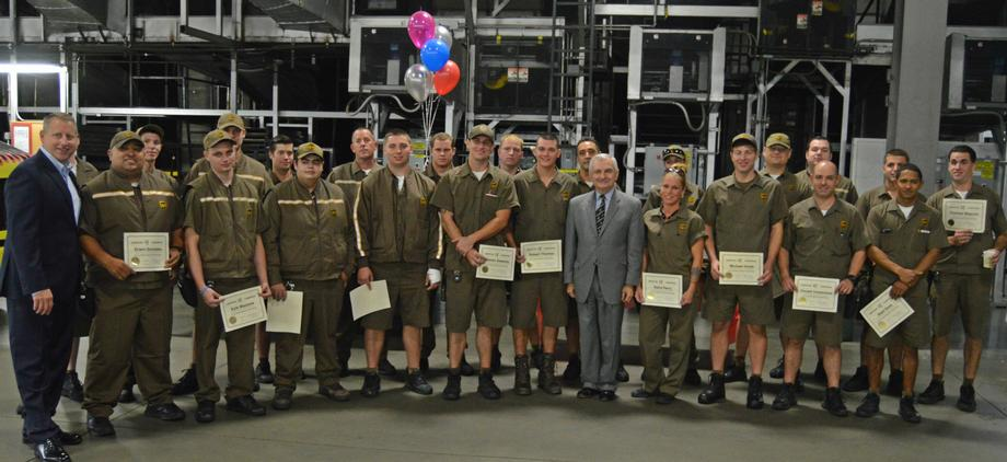 Reed Presents Certificates to New UPS Drivers