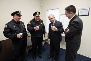 Reed jokes with state Rep. Ed Pacheco, right, and from left, Burrillville police Lt. Kevin S. SanAntonio and Police Chief Bernard Gannon at the Pascoag Water Authority. Journal photo / Mary Murphy