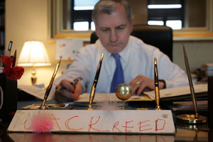 Senator Reed works at his office in the Hart Senate office building in Washington. The name plate was made years ago by the niece of a former staffer. Journal photo / Mary Murphy