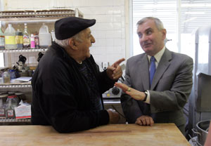 Reed chats with Joseph Monda, owner of the building that houses Buono's Bakery on Hartford Avenue, in Cranston. Reed grew up on Pontiac Avenue in that city